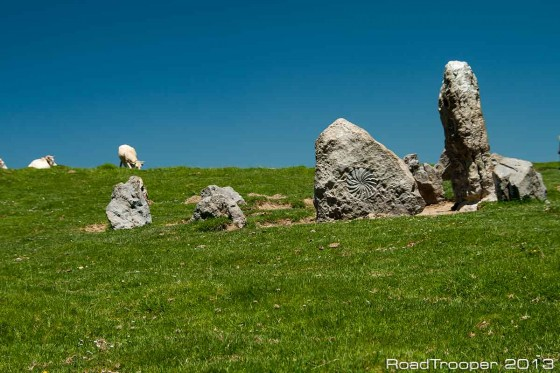 The D428, Basque Pyrenees. Basque Sun Symbol carved into a rock and part of a stone circle.